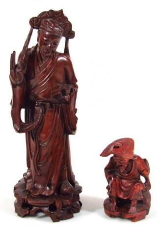 A Chinese hardwood figure of a gentleman standing holding sceptre and book