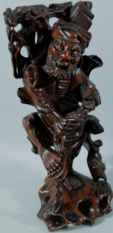 A heavily carved Chinese hardwood figure group