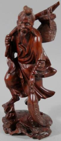 A heavily carved Chinese figure group