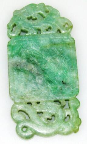 A Chinese tri-colour carved jade pendant
