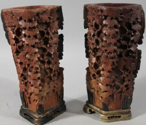 A near matching pair of 20thC carved Chinese soapstone vases