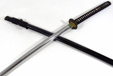 A 20thC Japanese samurai sword and black lacquer scabbard