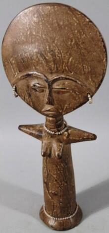 A 20thC carved tribal figure