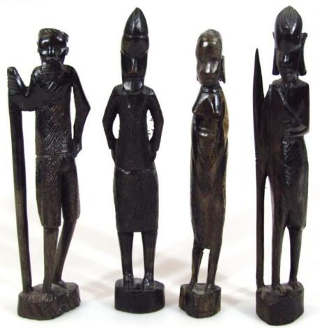 Four various carved wooden ebonised African tribal figures