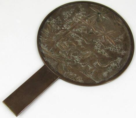 A Chinese late Qing period brass face screen mirror
