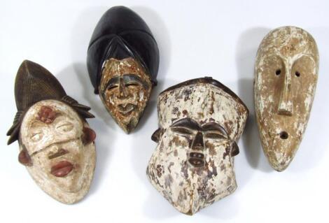 Four various carved African tribal hardwood face masks