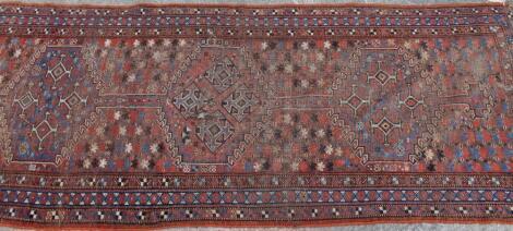 A late 19thC Persian carpet runner