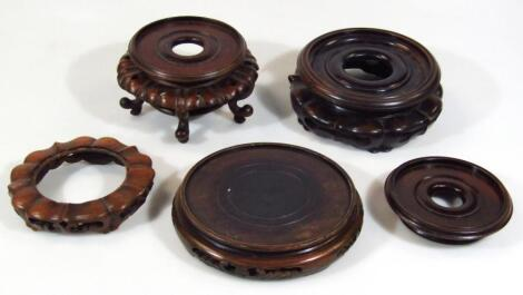 A pair of Chinese hardwood vase stands