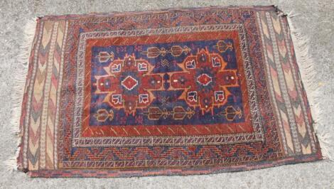 A 20thC woollen rug