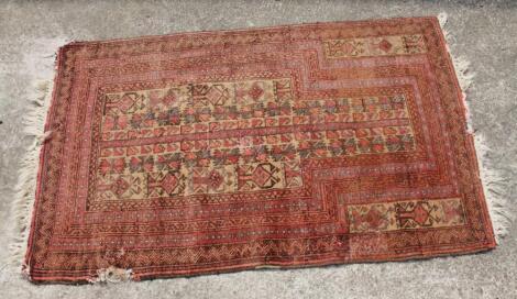 An early 20thC woollen rug