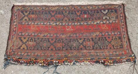A Middle Eastern woollen rug