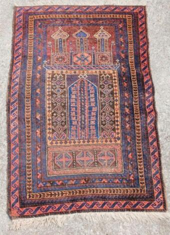 A 20thC Middle Eastern woollen rug
