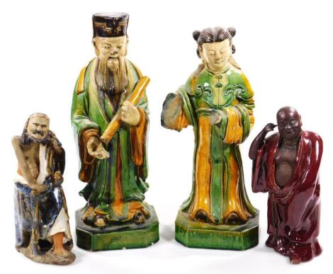 A pair of Chinese pottery Ming style figures