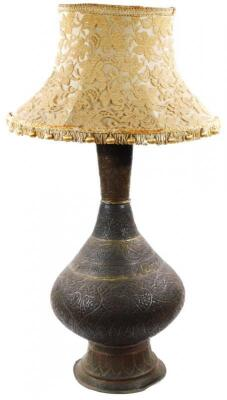 A Middle Eastern metal vase