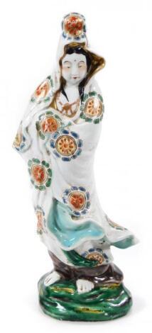 An oriental semi porcelain figure