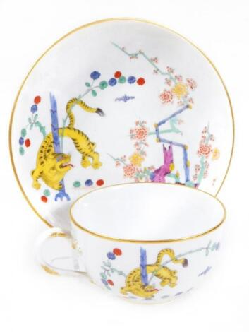 An early 19thC Meissen porcelain cup and saucer