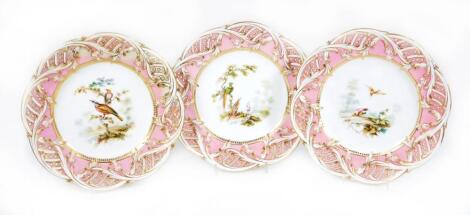 A set of three mid 19thC porcelain pink ground reticulated plates