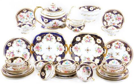 A 19thC Rockingham marked porcelain tea service