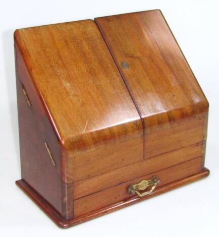 An Edwardian mahogany desk tidy