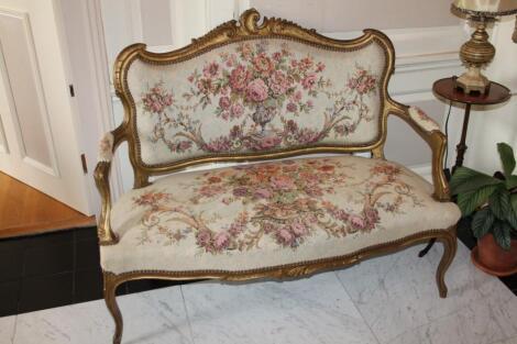 A Louis XV style giltwood boudoir sofa