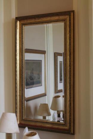 A pair of gilt framed rectangular wall mirrors