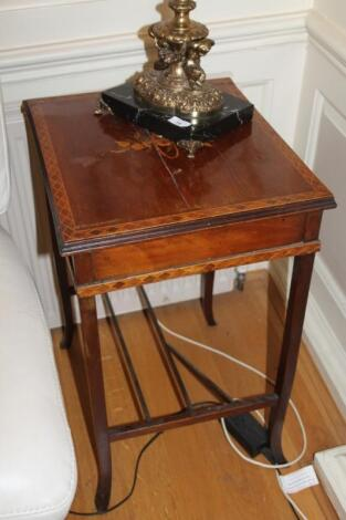 An Edwardian mahogany marquetry occasional table