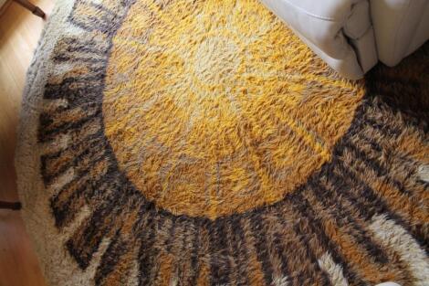 A circular woollen rug