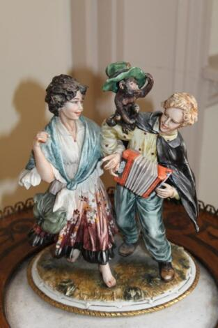 A Naples figure group of The Accordion Player