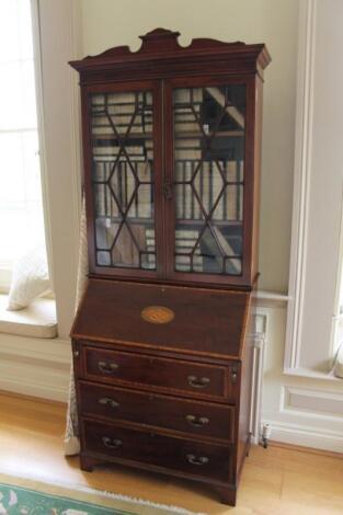 A Sheraton style cross banded mahogany bureau bookcase