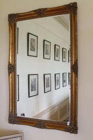 A gilt framed wall mirror
