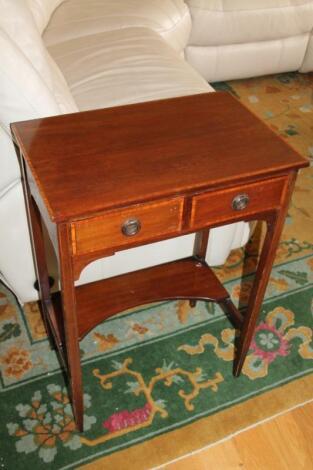 An Edwardian mahogany side table