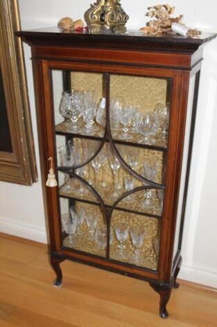An Edwardian string inlaid mahogany display cabinet