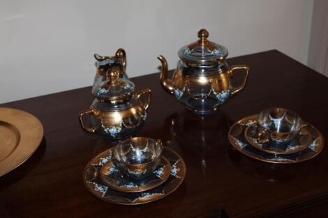 A Venetian enamelled blue glass coffee service