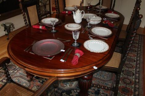 A Victorian style mahogany dining table