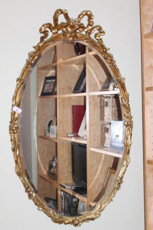 A reproduction oval wall mirror