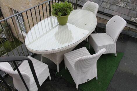 A suite of Bridgmans 4 Seasons Outdoor oval loom table and four loom chairs.