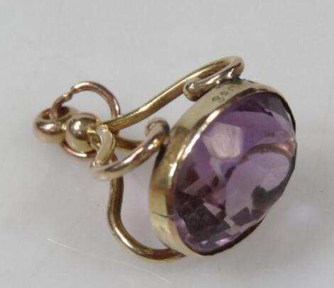 A 9ct gold seal fob set with a faceted amethyst