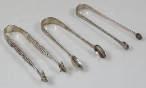 Three pairs of Georgian silver sugar tongs.
