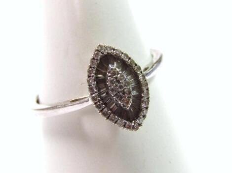 A marquise shaped diamond dress ring