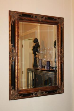 A reproduction wall mirror