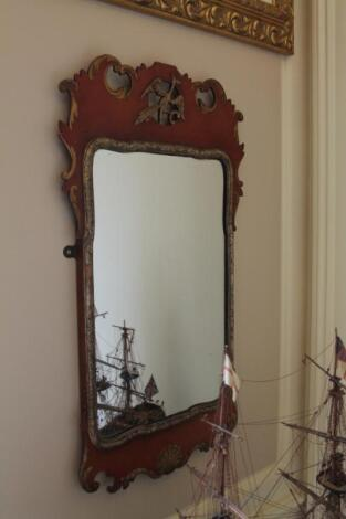 A reproduction Georgian red lacquer and parcel gilt pier glass