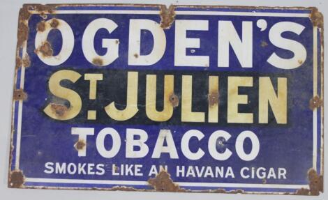 An early 20thC enamel metal sign Ogden's St Julien Tobacco Smokes Like An Havana Cigar