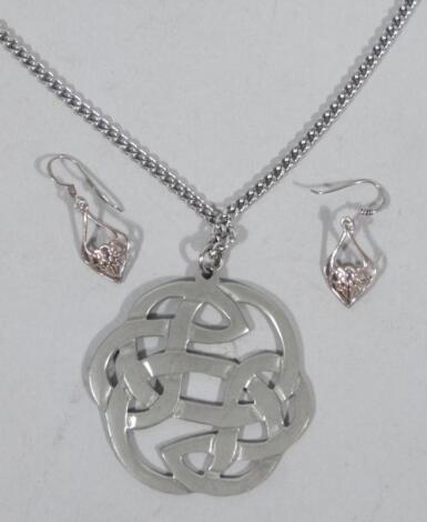 Two items of St Justin jewellery