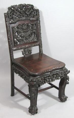 A Chinese Qing period carved chair