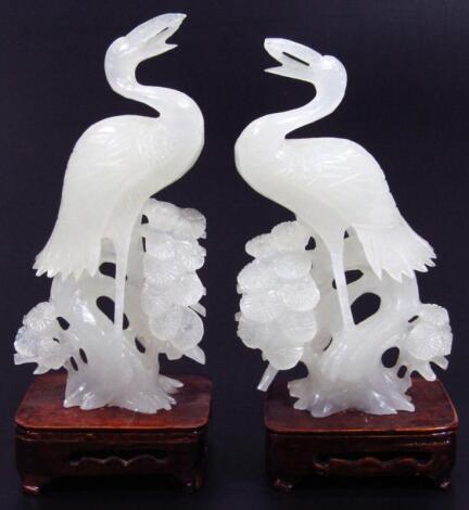 A pair of modern white jade carvings of herons
