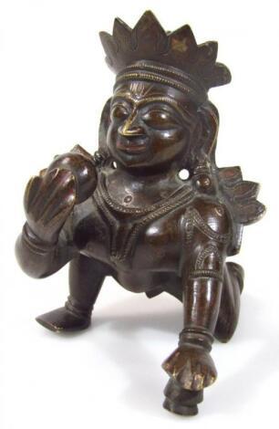 An Indian bronze figure of Krishna with butter pot