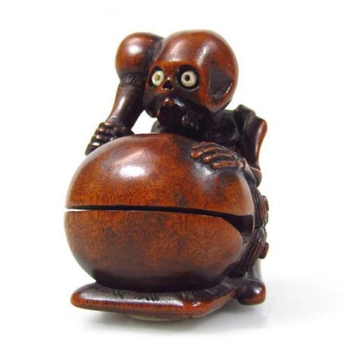 A Meiji period Japanese carved hardwood netsuke