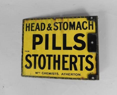 A Stotherts Ltd black and yellow rectangular enamel advertising sign