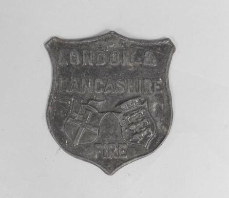 A reproduction London & Lancashire Fire lead shield shaped insurance plaque