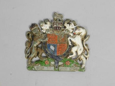 A painted early 20thC cast metal Royal Coat of Arms wall plaque
